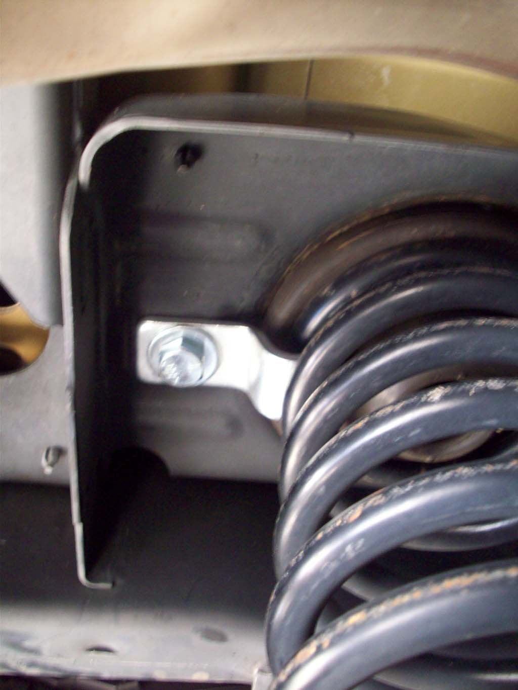 3 Install The Bolt And Washer Up Through The Coil Spring