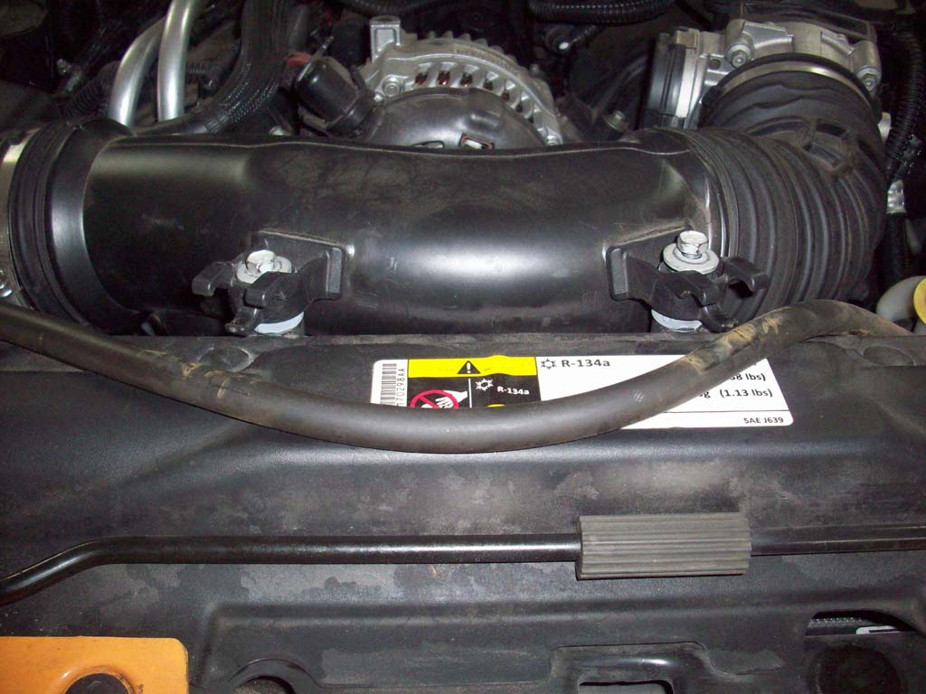 P0128 Code Engine Thermostat Replacement 36l 2005 Jeep Liberty Limited Coolant Diagram Pull The Rubber Radiator Overflow Hose Out Of Two 2 Clips